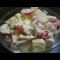 Фото Салат с копченой курицей, двумя сырами и помидорами черри