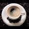 Фото Черный двойной кофе в турке