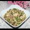 Фото Рисовый салат с куриными рулетиками и зеленым горошком