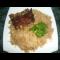 Фото Тушеная квашеная капуста с рисом и бараньими ребрышками