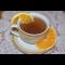 Фото Согревающий напиток из апельсиновой кожуры и корицы