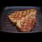 Фото Стейк из свинины на сковороде-гриль с розмарином