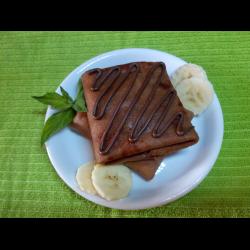 Рецепт: Шоколадные блинчики с банановой начинкой