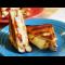 Фото Горячий бутерброд с сыром и томатами