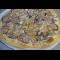 Фото Пицца с тунцом и красным луком