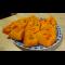 Фото Тыква с цукатами, приготовленная в сковороде